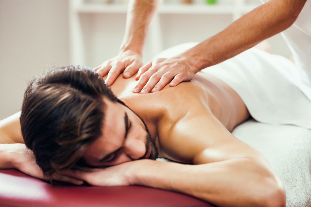 two hands on back massage